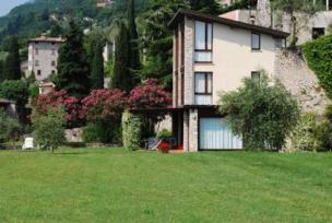 Villa im Zitronengarten mit Seeblick, mit Park am See und privat Garten