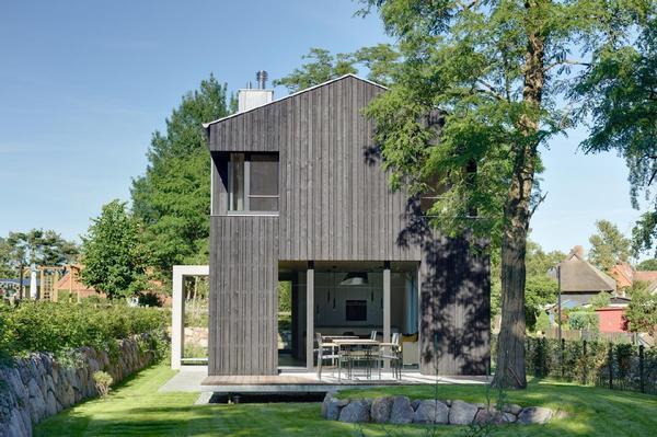 architektenhaus auf dem darß, offener wohnbereich mit kamin, große, Wohnzimmer dekoo