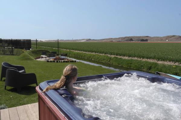 Ferienhaus julianadorp aan zee mit pool f r bis zu 9 for Huisje met sauna en jacuzzi 2 personen